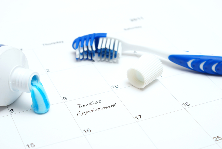 A note of a dentist appointment on a calendar reminds the patient. ** Note: Shallow depth of field