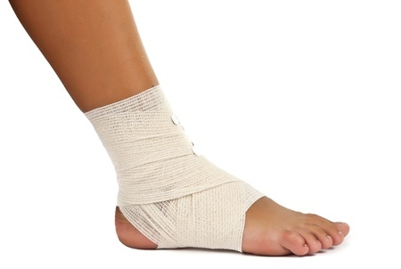 14805063 - injured ankle with bandage on a white background